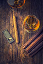 Quality cigars and cognac on an old wooden table Royalty Free Stock Photography