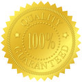 Quality guaranteed gold seal with embossed decorations Stock Photos