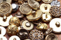 Quantity of vintage metal buttons on wooden surface image shows a assorted showing a variety patterns and textures the are a Royalty Free Stock Photos