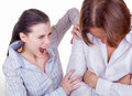 Quarrel an angry young women brandishing her husband on a light background Stock Photos