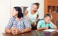 Quarrel of family three with teenager son having at home Royalty Free Stock Photography