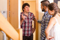 Quarrel with neighbour indoor young couple having conflict angry at the door Stock Images
