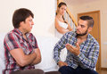 Quarrel with neighbour indoor young family couple having Stock Photo