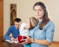 Quarrel over money family of three with baby having Royalty Free Stock Photography