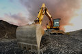 Quarry excavator image of a wheeled on a tip Stock Image