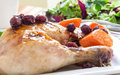 Quarter roast chicken served potato carrots cranberry Royalty Free Stock Photo