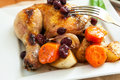 A quarter of roast chicken served with potato carrots and cranberry Royalty Free Stock Images