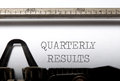 Quarterly results heading printed on a typewriter Stock Image