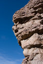 Quartzite cliff with blue sky Royalty Free Stock Photo