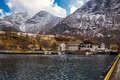 Quay fjord with mountains in the background in the norwegian town of flam Stock Image