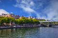 Quay of paris famous river seine in with buildings and trees Stock Photos