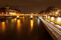 Quay and pont au change in paris at night panorama of seine with Royalty Free Stock Image