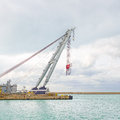 Quay Port Crane for industrial container, cargo, ship or boat. Royalty Free Stock Image