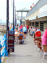 Quayside torquay devon a pavement cafe on the side of the harbor at england uk Stock Image