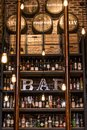 Quebec Canada 13.09.2017 - Bitters and liquor bar counter with bottles toned vintage style brick wall and ambient light Royalty Free Stock Photo