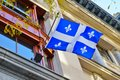 A Quebec flag with white lily flowers in Montreal, Canada Royalty Free Stock Photo