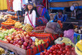 Quechua Indian women bargain and sell vegetables > Royalty Free Stock Photo