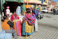 Quechua woman in traditional cloth at the market Royalty Free Stock Photo