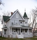 A queen anne on a cloudy day this is fall picture of the g w s allen house located in mt pleasant iowa this house was designed by Stock Photography