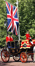 Queen elizabeth ii on the royal coach london uk june seat at s birthday parade union jack and man present s Royalty Free Stock Image