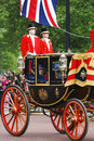 Queen elizabeth ii on the royal coach london uk june seat at s birthday parade union jack and man present s Royalty Free Stock Photos