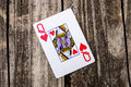 Queen of Hearts Card on Wood Royalty Free Stock Photo