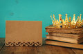 queen/king crown on old book. vintage filtered. fantasy medieval period Royalty Free Stock Photo