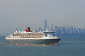 Queen mary cruise ship in new york harbor heading for canada and new england city july on july Stock Photo