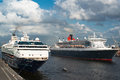 Queen mary and mein schiff the great luxury cruise ships hamburg germany may one of largest most in world is passing another Royalty Free Stock Image