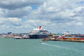 Queen mary ocean going transatlantic liner and cruise ship at southampton docks england uk with colourful dockside containers Stock Photography