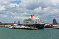 Queen mary ocean going transatlantic liner and cruise ship at southampton docks england uk with dockside containers Stock Images