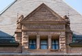 Queen s park building architectural detail ricardsonian romanesque revival architecture beautiful window with lions under the roof Royalty Free Stock Images