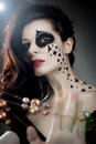 Queen of spades a woman with facial paint the suit Stock Photos