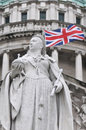 Queen Victoria Statue with Union Flag Behind Royalty Free Stock Photo