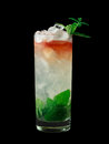 Queens Park Swizzle cocktail on black background Royalty Free Stock Photo