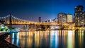 Queensboro bridge by night viewed from roosevelt island new york Stock Photo