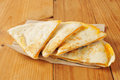 Quesadillas on a napkin cheddar cheese rustic wooden table Royalty Free Stock Photos