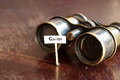 Quest concept old binoculars and an inscription Royalty Free Stock Photo