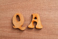 Question and answer letters over wooden table Stock Photography