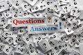 Question answers questions and on white papers hard light Royalty Free Stock Photo
