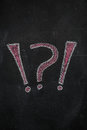 Question and exclamation marks on black chalkboard Royalty Free Stock Photo