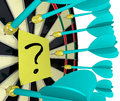 Question mark on dart board shooting for answers several darts aim but miss a yellow sticky note with a written it symbolizing an Royalty Free Stock Image