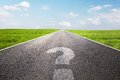 Question mark symbol on long empty straight road, highway Royalty Free Stock Photo