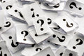 Question marks lot of on white papers hard light Royalty Free Stock Image