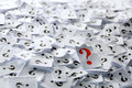 Question marks lot of on white papers hard light Stock Photography