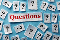 Question marks lot of on white papers hard light Stock Images