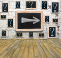 Question marks white chalk drawing on small blackboard hanging old brick wall Royalty Free Stock Photos