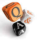 Questions and answers orange black dice blocks on white background clipping path included Royalty Free Stock Image