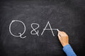Questions and answers q and a concept blackboard question answer support help chalkboard with hand writing Stock Images