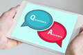 Questions and answers q a session concept with hands holding modern tablet or smartphone to be used as slide background Royalty Free Stock Photography